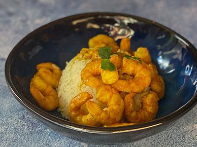 Crevettes à la crème de citron confit à l'harissa et riz camarguais